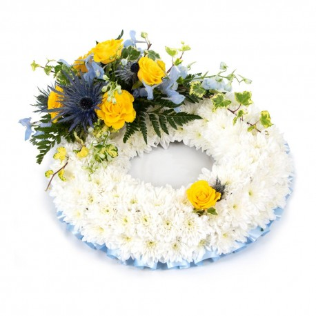 White based Wreath with yellow top spray SYM-319
